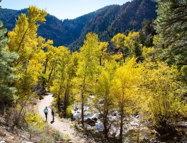 Two people hiking on trail in fall near Glenwood Springs